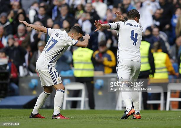 Sergio Ramos of Real Madrid celebrates with Lucas Vazquez after scoring their team's second goal during the La Liga match between Real Madrid and...