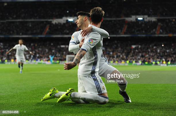 Sergio Ramos of Real Madrid celebrates with Marco Asensio after scoring Real's 2nd goal during the La Liga match between Real Madrid CF and Real...