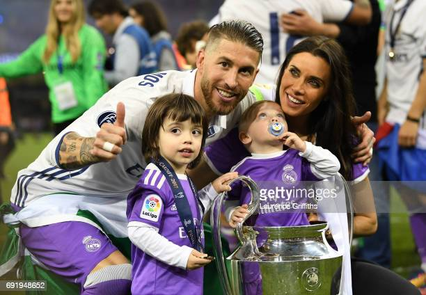 Sergio Ramos of Real Madrid celebrates with The Champions League trophy with his wife and children during the UEFA Champions League Final between...