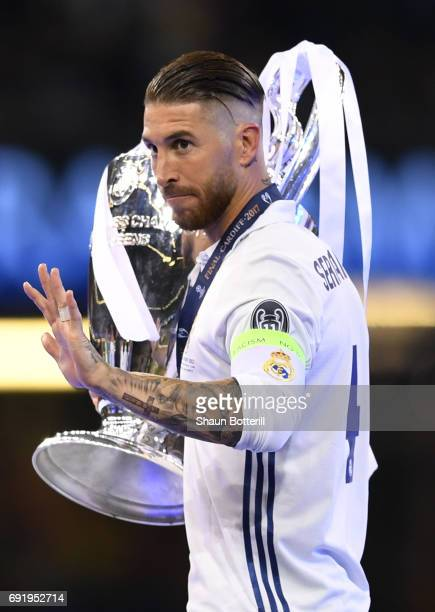 Sergio Ramos of Real Madrid celebrates with The Champions League trophy after the UEFA Champions League Final between Juventus and Real Madrid at...