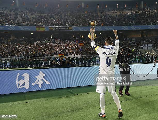 Sergio Ramos of Real Madrid celebrates with the trophy after the FIFA Club World Cup Final match between Real Madrid and Kashima Antlers at...