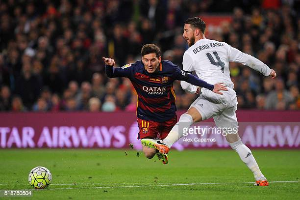 Sergio Ramos of Real Madrid CF battles for the ball with Lionel Messi of FC Barcelona during the La Liga match between FC Barcelona and Real Madrid...
