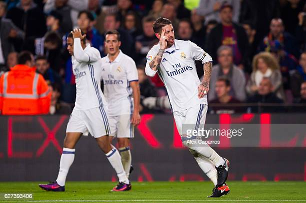 Sergio Ramos of Real Madrid CF celebrates after scoring his team's first goal during the La Liga match between FC Barcelona and Real Madrid CF at...