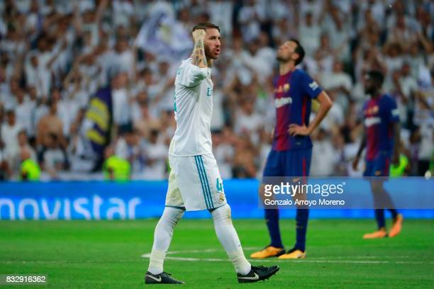 Sergio Ramos of Real Madrid CF celebrates ahead Sergio Busquets Burgos of FC Barcelona after winning the Supercopa de Espana Final 2nd Leg match...