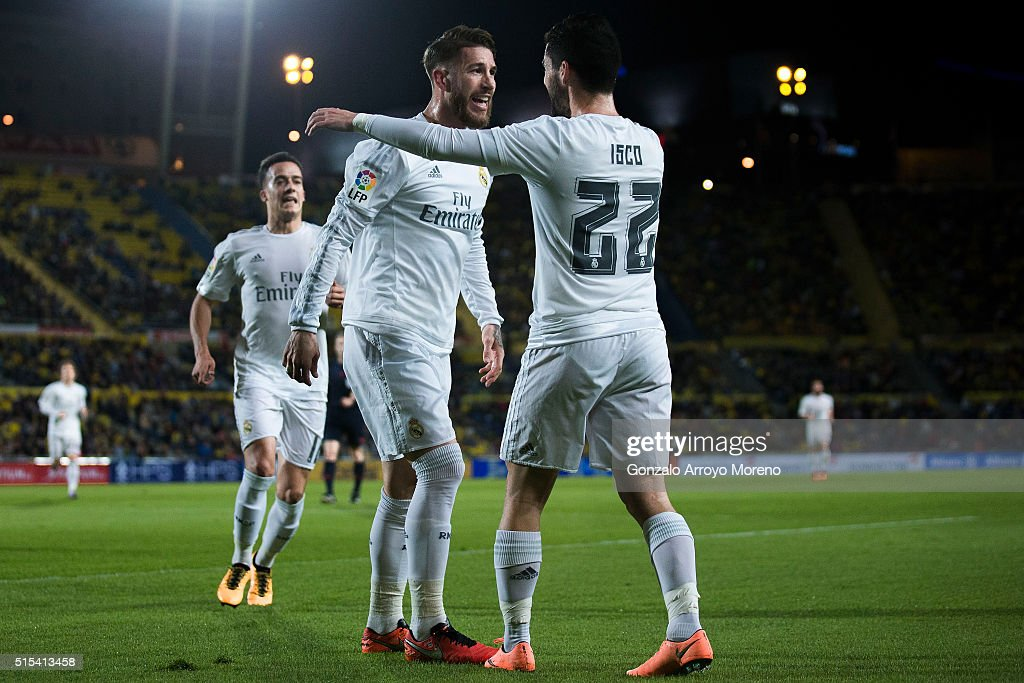 Sergio Ramos (2ndL) of Real Madrid CF celebrates scoring their opening goal with teammate Francisco Roman Alarcon alias <a gi-track='captionPersonalityLinkClicked' href=/galleries/search?phrase=Isco&family=editorial&specificpeople=5848609 ng-click='$event.stopPropagation()'>Isco</a> (R) during the La Liga match between UD Las Palmas and Real Madrid CF at Estadio de Gran Canaria on March 13, 2016 in Las Palmas, Spain.