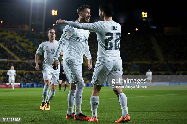 Sergio Ramos of Real Madrid CF celebrates scoring their opening goal with teammate Francisco Roman Alarcon alias Isco during the La Liga match...