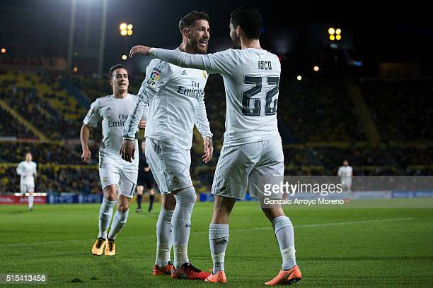 Sergio Ramos of Real Madrid CF celebrates scoring their opening goal with teammate Francisco Roman Alarcon alias Isco during the La Liga match...