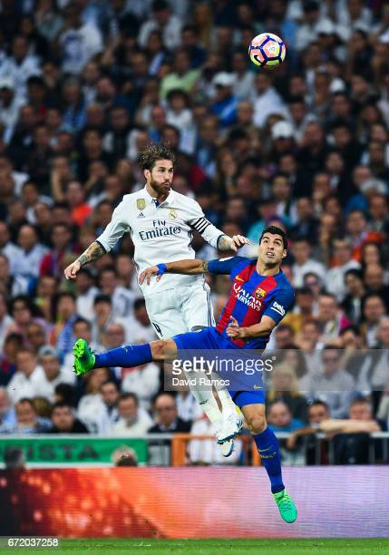 Sergio Ramos of Real Madrid CF competes for the ball with Luis Suarez of FC Barcelona during the La Liga match between Real Madrid CF and FC...