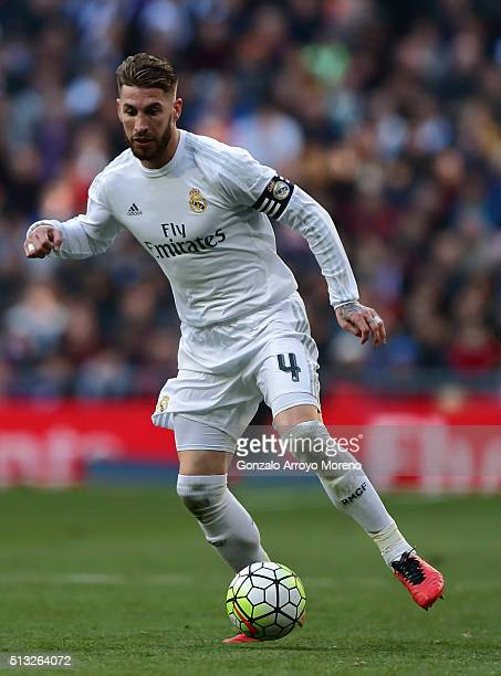 Sergio Ramos of Real Madrid CF controls the ball during the La Liga match between Real Madrid CF and Club Atletico de Madrid at Estadio Santiago...