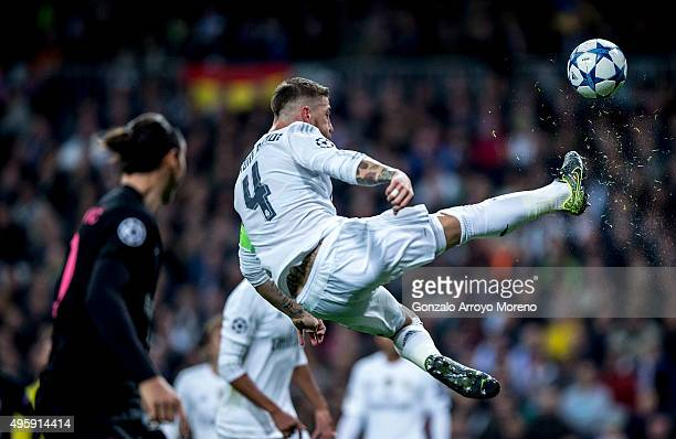 Sergio Ramos of Real Madrid CF does a scissor kick during the UEFA Champions League Group A match between Real Madrid CF and Paris SaintGermain at...