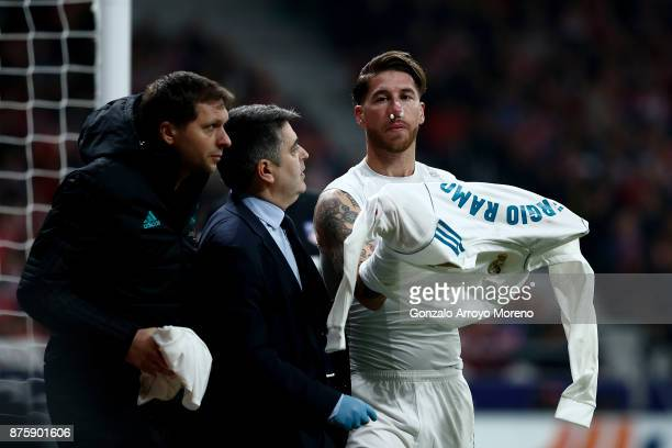 Sergio Ramos of Real Madrid CF gestures with his nose bleeding during the La Liga match between Club Atletico Madrid and Real Madrid CF at Estadio...