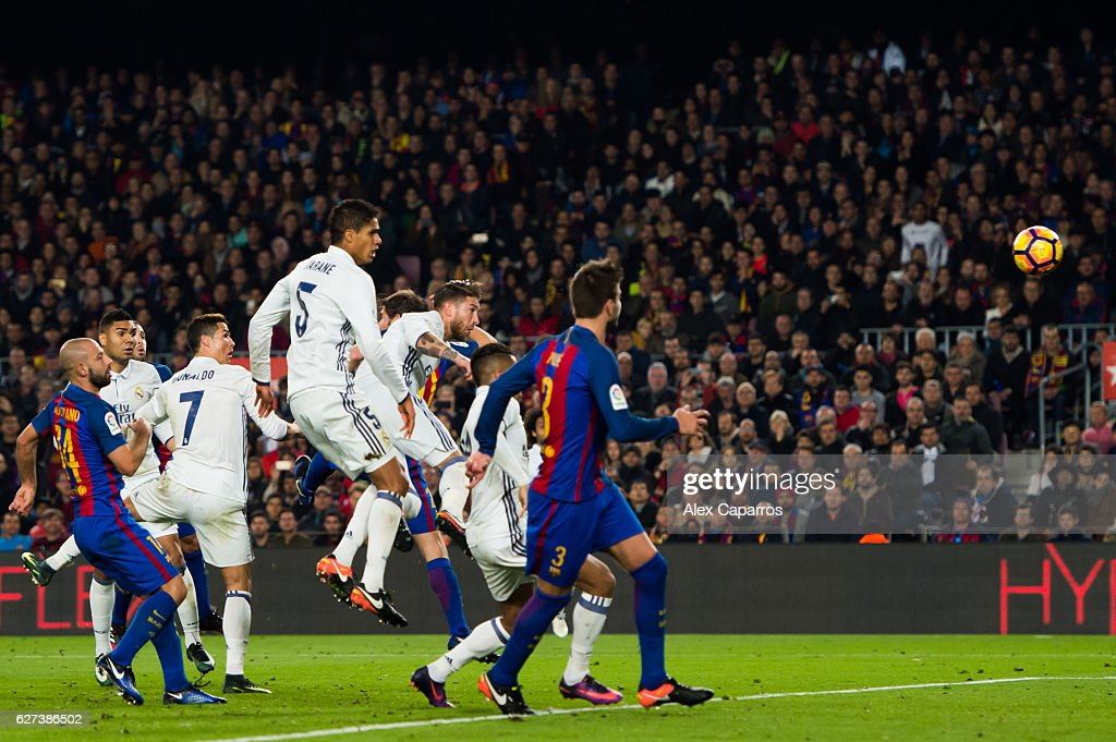 Sergio Ramos of Real Madrid CF heads the ball towards goal and scores his team's first goal during the La Liga match between FC Barcelona and Real...