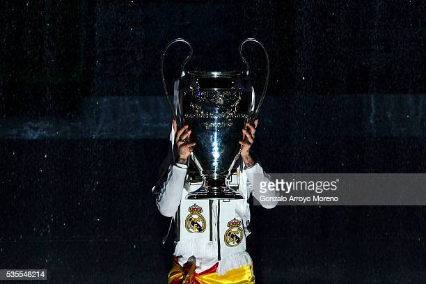 Sergio Ramos of Real Madrid CF holds the trophy as appreciation to the audience during Real Madrid CF team celebration at Santiago Bernabeu Stadium...