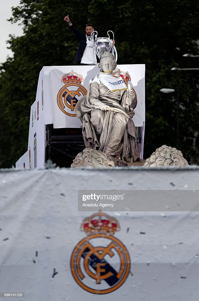 Sergio Ramos of Real Madrid CF holds the trophy in celebration during their team celebration at Cibeles square after winning the Uefa Champions League Final match agains Club Atletico de Madrid on May 29, 2016 in Madrid, Spain.