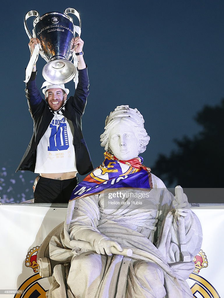 Sergio Ramos of Real Madrid CF holds the UEFA Champions League cup celebrating their victory on the UEFA Champions League Final match against Club Atletico de Madrid at Cibeles font on the early morning of May, 25, 2014 in Madrid, Spain.