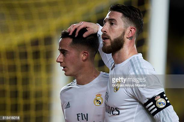 Sergio Ramos of Real Madrid CF hugs Lucas Vazquez as they walk to the dressing room after the first half during the La Liga match between UD Las...