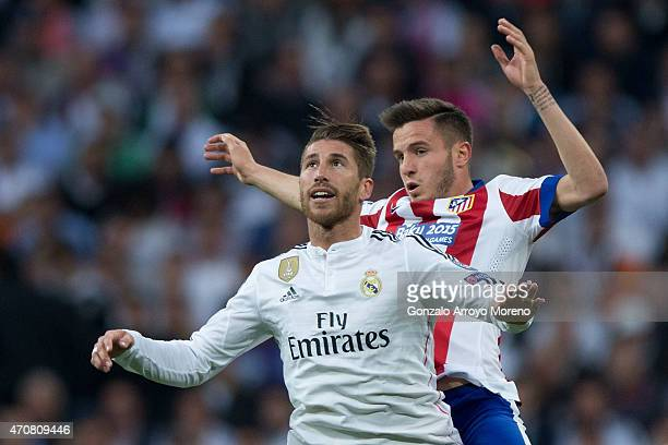 Sergio Ramos of Real Madrid CF jumps for the ball ahead Saul Niguez of Atletico de Madrid during the UEFA Champions League quarterfinal second leg...