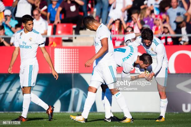 Sergio Ramos of Real Madrid CF kisses the boot of his teammate Francisco Alarcon 'Isco' after he scored the opening goal during the La Liga match...