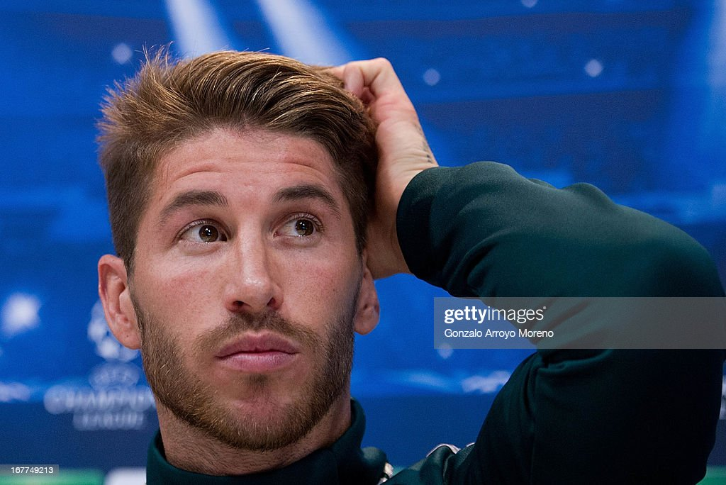 <a gi-track='captionPersonalityLinkClicked' href=/galleries/search?phrase=Sergio+Ramos+-+Jugador+de+f%C3%BAtbol&family=editorial&specificpeople=491009 ng-click='$event.stopPropagation()'>Sergio Ramos</a> of Real Madrid CF listen to questions from the media during a press conference ahead of the UEFA Champions League Semifinal second leg match between Real Madrid and Borussia Dortmund at the Valdebebas training ground on April 29, 2013 in Madrid, Spain.