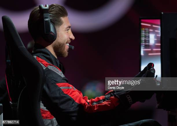 Sergio Ramos of Real Madrid CF races in his simulated Formulae car during a race with his teammates during the Audi Handover Sponsorship deal with...