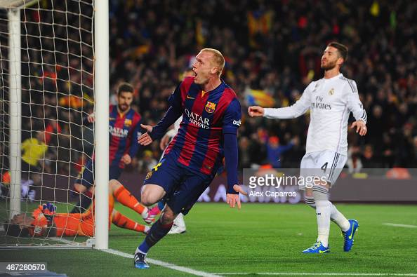 Sergio Ramos of Real Madrid CF reacts as Jeremy Mathieu of Barcelona celebrates as he scores their first goal with a header during the La Liga match...