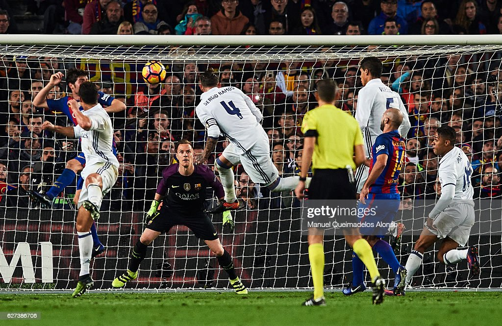 Sergio Ramos of Real Madrid CF shoots for score the first goal of Real Madrid during La Liga match between FC Barcelona and Real Madrid CF at Camp...