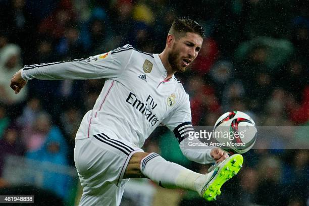 Sergio Ramos of Real Madrid CF strikes the ball during the Copa del Rey Round of 16 second leg match between Real Madrid CF and Club Atletico de...