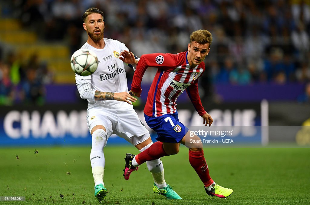Sergio Ramos of Real Madrid (L) challenges <a gi-track='captionPersonalityLinkClicked' href=/galleries/search?phrase=Antoine+Griezmann&family=editorial&specificpeople=7197539 ng-click='$event.stopPropagation()'>Antoine Griezmann</a> of Atletico Madrid during the UEFA Champions League Final between Real Madrid and Club Atletico de Madrid at Stadio Giuseppe Meazza on May 28, 2016 in Milan, Italy..