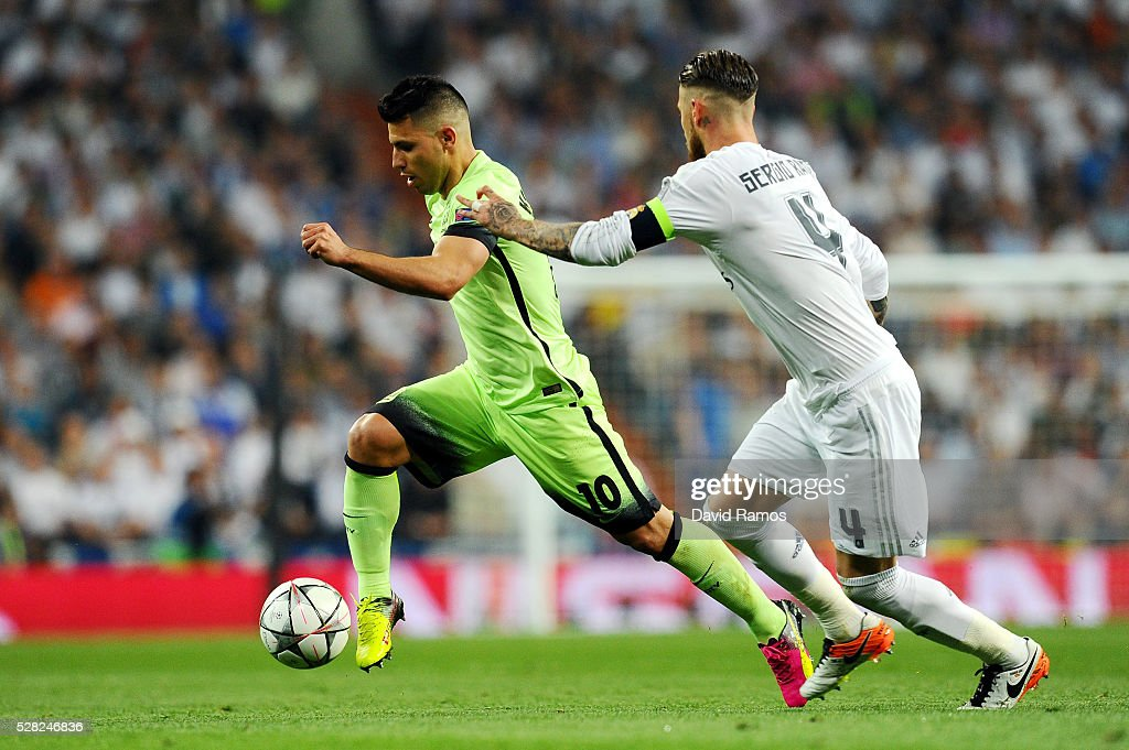 Sergio Ramos of Real Madrid chases <a gi-track='captionPersonalityLinkClicked' href=/galleries/search?phrase=Sergio+Aguero&family=editorial&specificpeople=1100704 ng-click='$event.stopPropagation()'>Sergio Aguero</a> of Manchester City during the UEFA Champions League semi final, second leg match between Real Madrid and Manchester City FC at Estadio Santiago Bernabeu on May 4, 2016 in Madrid, Spain.