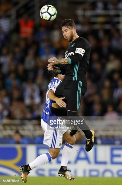 Sergio Ramos of Real Madrid competes for the ball with Alvaro Odriozola of Real Sociedad during the La Liga match between Real Sociedad and Real...