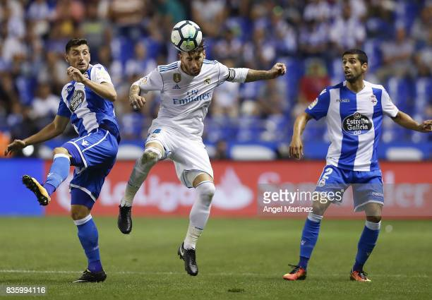 Sergio Ramos of Real Madrid competes for the ball with Fabian Schar of Deportivo La Coruna during the La Liga match between Deportivo La Coruna and...