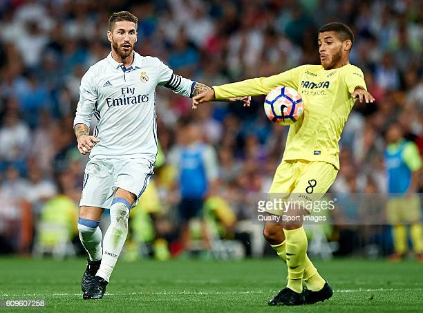 Sergio Ramos of Real Madrid competes for the ball with Jonathan Dos Santos of Villarreal during the La Liga match between Real Madrid CF and...
