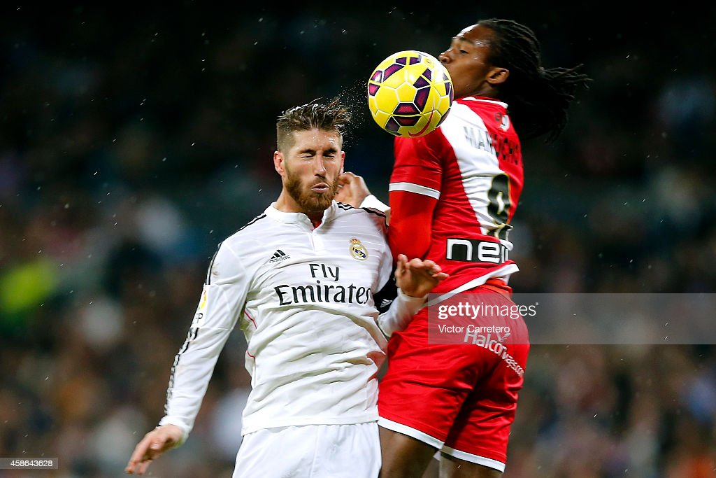 Sergio Ramos (L) of Real Madrid competes for the ball with Manucho of Rayo Vallecano during the La Liga match between Real Madrid and Rayo Vallecano at Estadio Santiago Bernabeu on November 8, 2014 in Madrid, Spain.