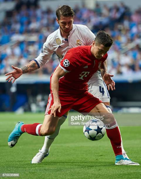 Sergio Ramos of Real Madrid competes for the ball with Robert Lewandowski of Bayern Muenchen during the UEFA Champions League Quarter Final second...