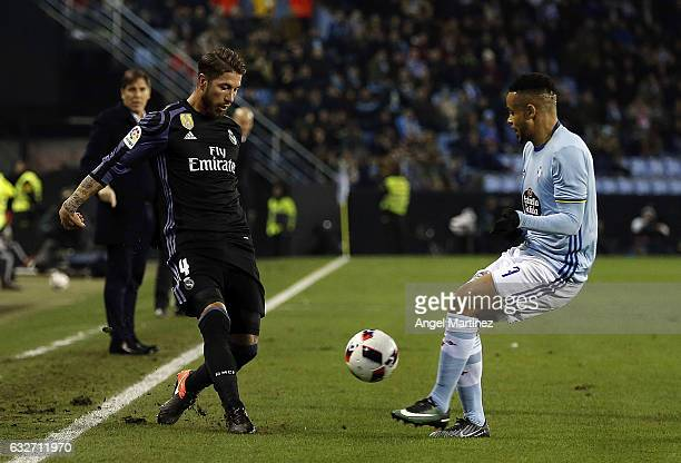 Sergio Ramos of Real Madrid competes for the ball with Theo Bongonda of Celta de Vigo during the Copa del Rey quarterfinal second leg match between...