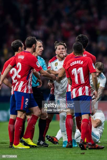 Sergio Ramos of Real Madrid confronts with Angel Correa of Atletico de Madrid during the La Liga 201718 match between Atletico de Madrid and Real...