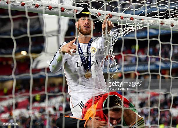 Sergio Ramos of Real Madrid cuts the goal netting as he celebrates during the UEFA Champions League Final between Real Madrid and Atletico de Madrid...