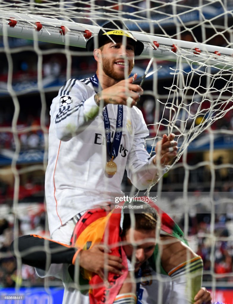 Sergio Ramos of Real Madrid cuts the goal netting as he celebrates during the UEFA Champions League Final between Real Madrid and Atletico de Madrid at Estadio da Luz on May 24, 2014 in Lisbon, Portugal.