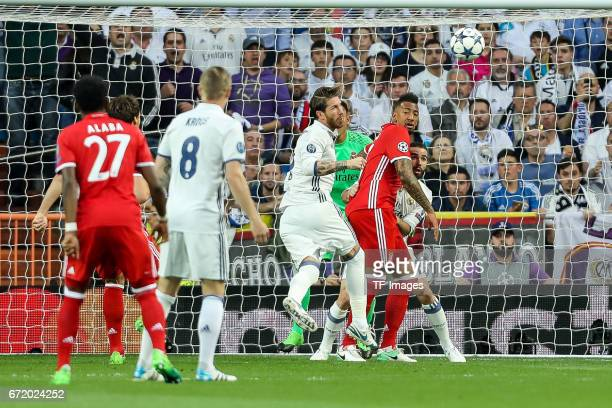 Sergio Ramos of Real Madrid Dani Carvajal of Real Madrid and Jerome Boateng of Munich battle for the ball during the UEFA Champions League Quarter...