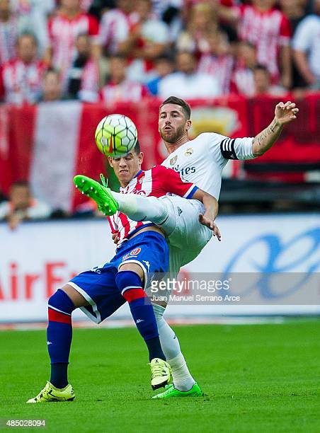 Sergio Ramos of Real Madrid duels for the ball with Arnaldo Sanabria of Real Sporting de Gijon during the La Liga match between Sporting Gijon and...