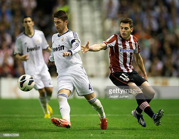 Sergio Ramos of Real Madrid duels for the ball with Ibai Gomez of Athletic Club during the la Liga match between Athletic Club and Real Madrid CF at...