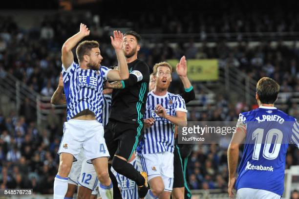 Sergio Ramos of Real Madrid duels for the ball with Illarramendi and Zurutuza of Real Sociedad during the Spanish league football match between Real...