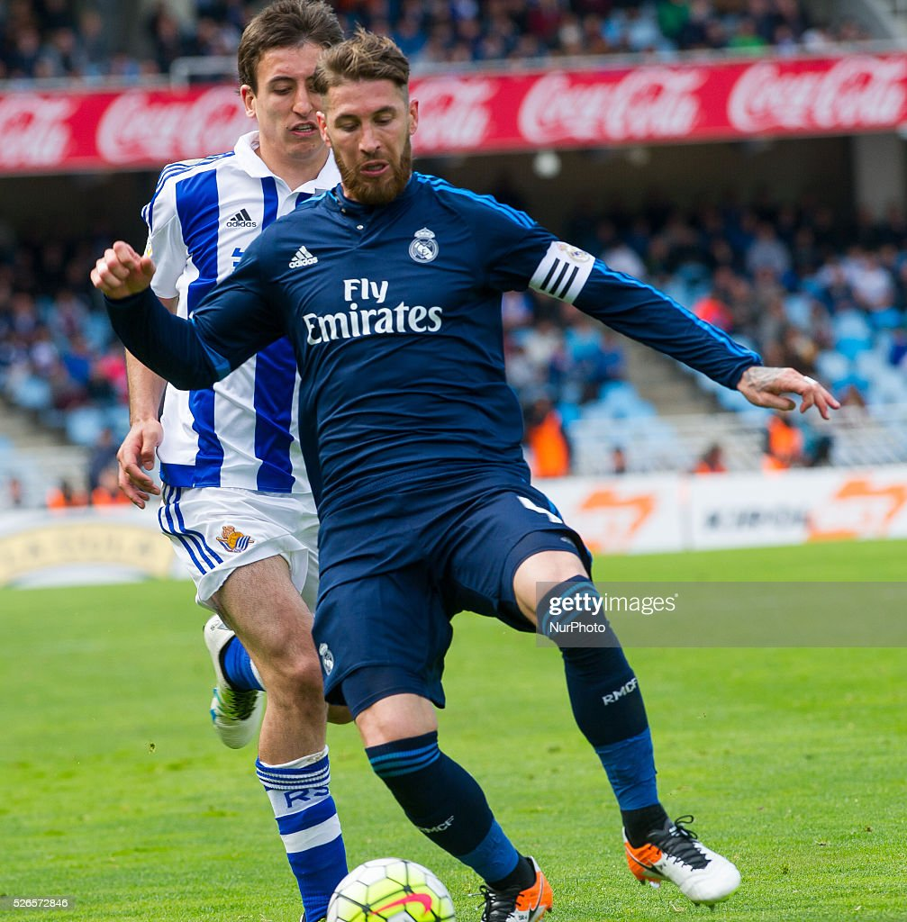 Sergio Ramos of Real Madrid duels for the ball with Oyarzabal of Real Sociedad during the Spanish league football match between Real Sociedad and Real Madrid at the Anoeta Stadium in San Sebastian on April 30, 2016