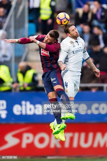 Sergio Ramos of Real Madrid duels for the ball withSergi Enrich of SD Eibar during the La Liga match between SD Eibar and Real Madrid at Ipurua...