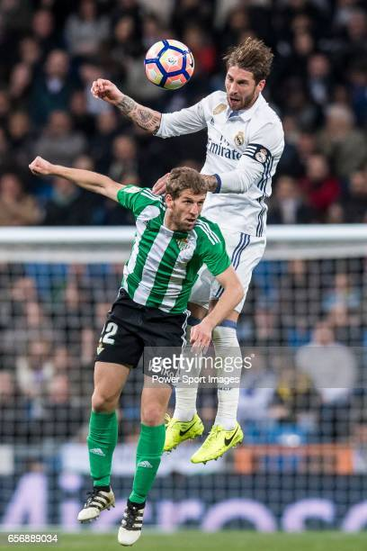 Sergio Ramos of Real Madrid fights for the ball with Darko Brasanac of Real Betis during their La Liga match between Real Madrid and Real Betis at...