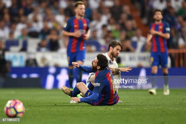 Sergio Ramos of Real Madrid fouls Lionel Messi of Barcelona and is sent off during the La Liga match between Real Madrid CF and FC Barcelona at...