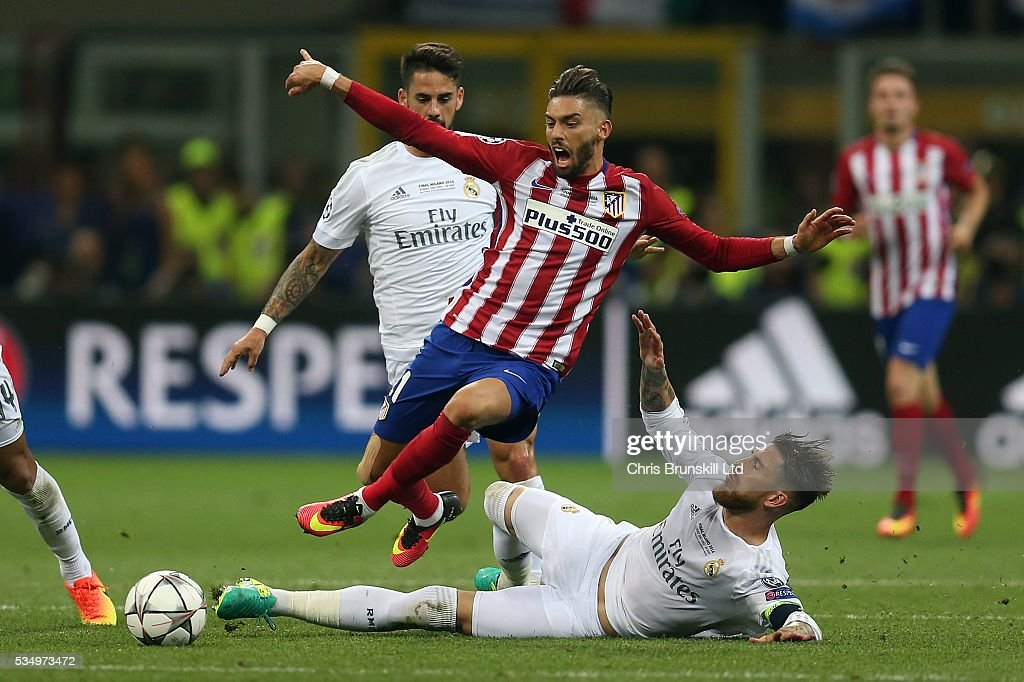 Sergio Ramos of Real Madrid fouls Yannick Carrasco of Club Atletico de Madrid during the UEFA Champions League Final between Real Madrid and Club Atletico de Madrid at Stadio Giuseppe Meazza on May 28, 2016 in Milan, Italy.