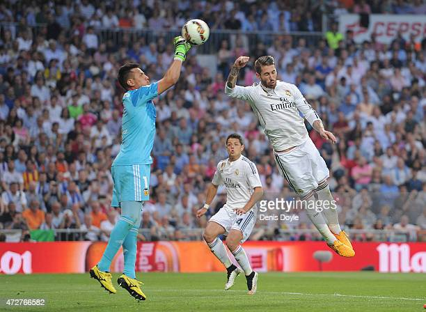 Sergio Ramos of Real Madrid goes for a high ball against Diego Alves of Valencia CF during the La Liga match between Real Madrid CF and Valencia CF...
