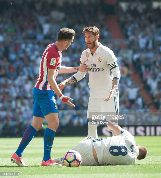 Sergio Ramos of Real Madrid had a word with Saul Niguez of Club Atletico de Madrid after he fouled Toni Kroos of Real Madrid during the La Liga match...