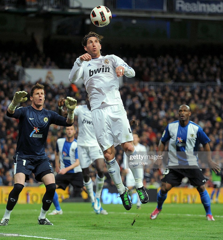 Sergio Ramos of Real Madrid heads the ball from a corner kick during the La Liga match between Real Madrid and Hercules CF at Estadio Santiago Bernabeu on March 12, 2011 in Madrid, Spain.